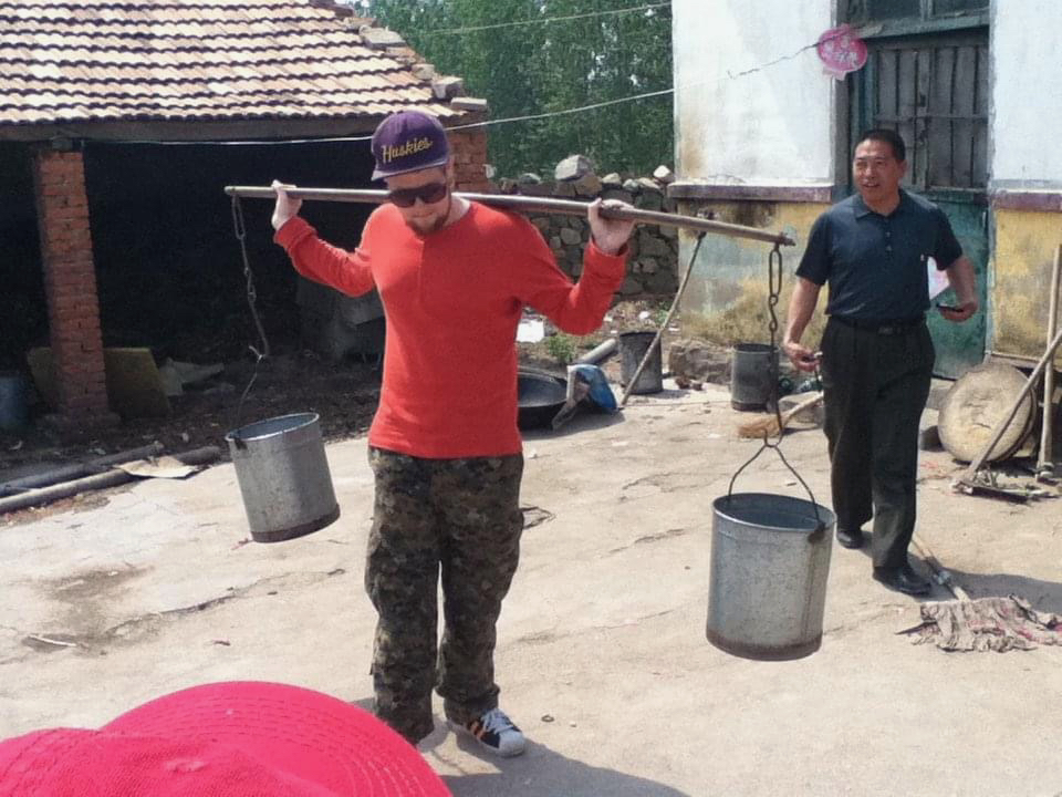 Blake Norman of Calgary on Daqingshan in 2011. In remote villages, people used this device to get well water to their house.